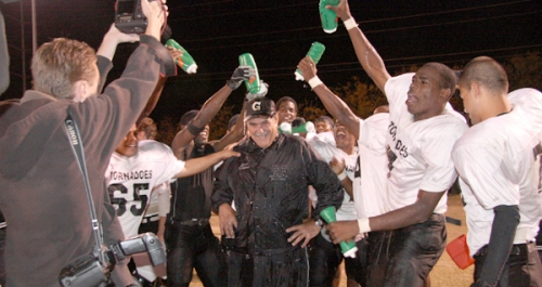 Gainesville State players douse head coach Mark Williams in celebration. Photo by Melinda Wright